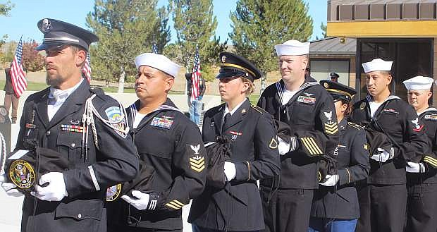 Matthew Cardin, left, of the Nevada Veterans Coalition leads members of the NVC, sailors from Naval Air Station Fallon and the Nevada Army National Guard.