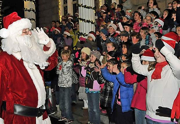Santa leads the children in song as they perform on the Capitol steps during a past Silver & Snowflakes Festival of Lights.