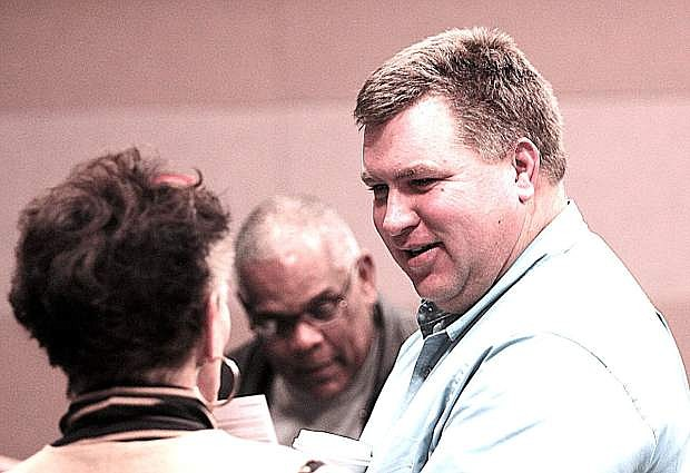 Sheriff-elect Richard Hickox, right, talks to supporters while waiting for election results.