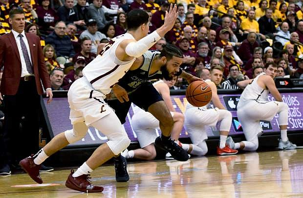 Nevada's Cody Martin drives to the basket against Loyola's Isaiah Bujdoso in Tuesday's first half.