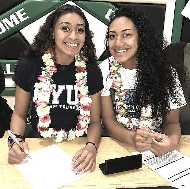 Leilani, left, and Leta Otuafi sign letters of intent to play basketball in Utah next year.