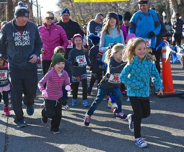 Kids leave the Turkey Trot start line for the Kid's 1-mile run in 2016.
