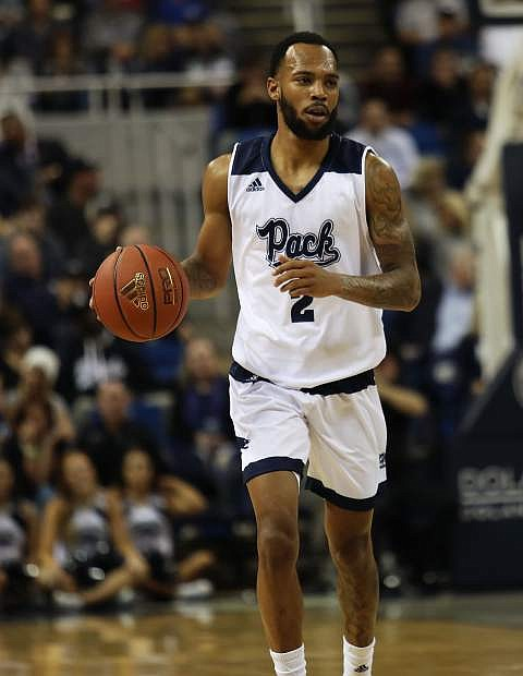 Guard Corey Henson brings the ball upcourt for Nevada on Nov. 6 in Reno. The Pack beat BYU, 86-70, in the season opener for both teams.