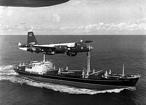 A Navy P-2H Neptune flies over a Soviet ship during the Cuban Missile Crisis.