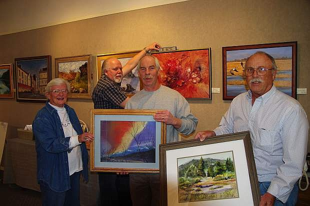 Nancy Clark with fellow artists at Carson City's NAA gallery.