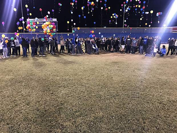 Those who participated in Monday night's service release their balloons.