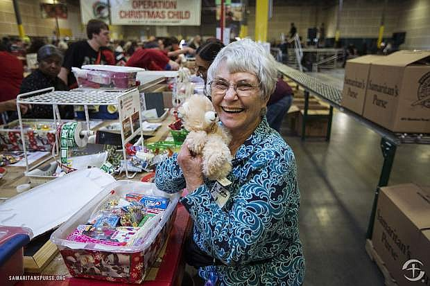 A volunteer helps to pack shoeboxes at a Samaritan's Purse distribution center.