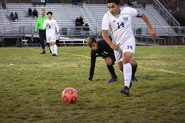 Daniel Escalante controls the ball for Carson on Monday.