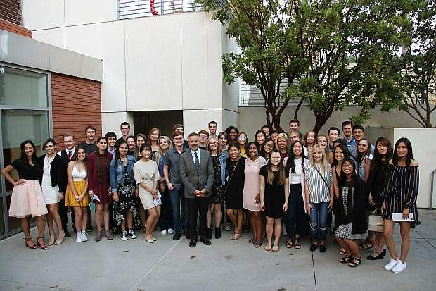 Biola University President Barry H. Corey stands with the 2018 President's Award scholarship recipients at a reception on campus.