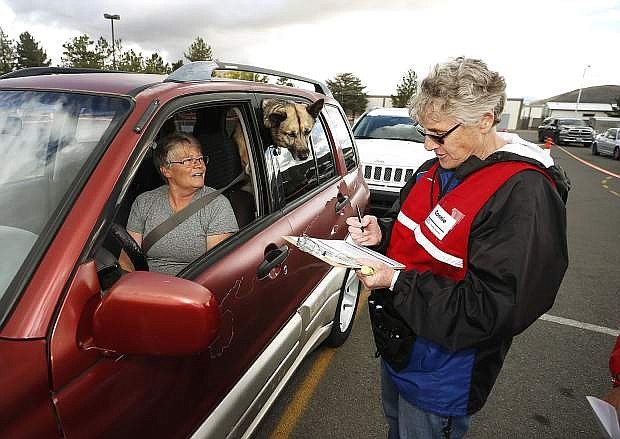 Trudi Gaye gets her flu shot during a drive-through Flu Shot Clinic in Carson City last month. The event, held by Carson City Health and Human Services in conjunction with a dozen local agencies, serves a point of distribution exercise to help the city be better prepared to handle emergencies. Photo by Cathleen Allison/Nevada Momentum