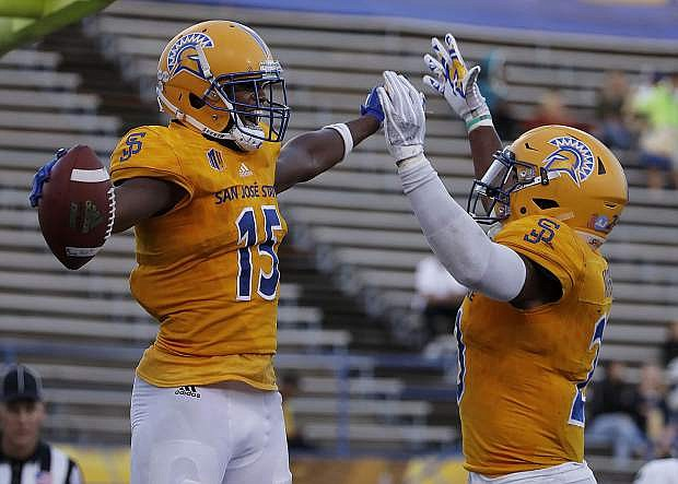 San Jose State wide receiver Tre Hartley, left, celebrates with running back Tyler Nevens after scoring a touchdown against UNLV on Oct. 27.