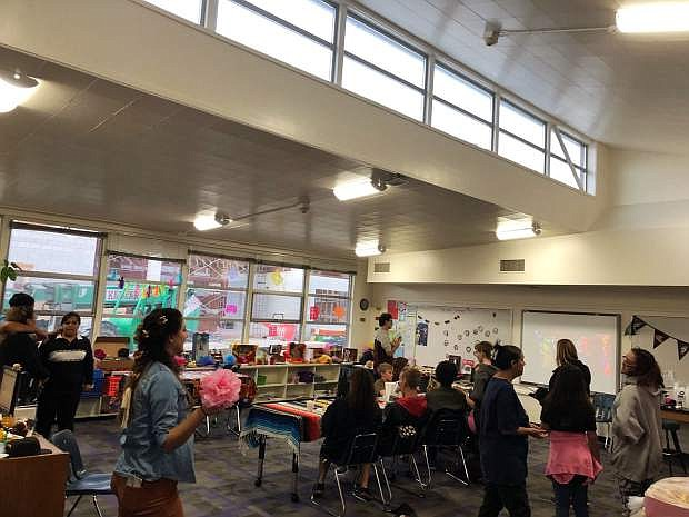 """The community gathered at Pioneer High School on Nov. 1 to participate in Dias de los Muertos while enjoying students' artwork, eating panes de dulces and watching Disney's movie """"Coco."""""""