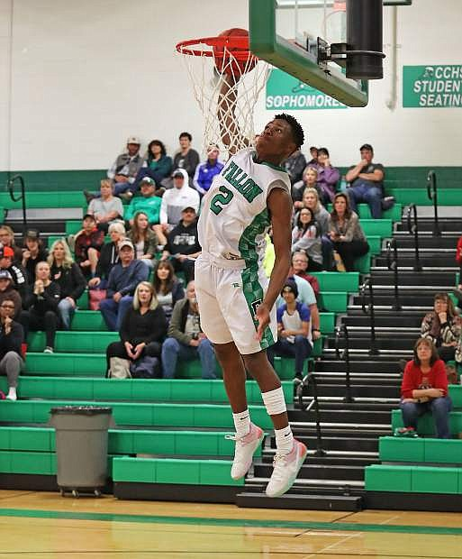 Junior Elijah Jackson dunks in the fourth quarter against North Valleys as he scored 37 points in the win.