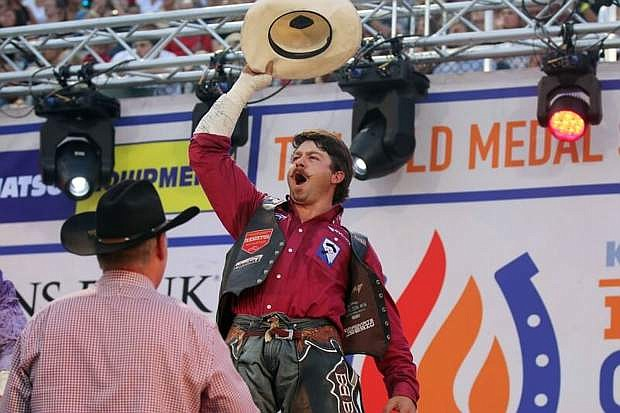 Minden's Wyatt Denny, shown celebrating after his win at the Days of 47 Rodeo in Salt Lake City earlier this summer, ended his season on a high note in bareback riding last week at the National Finals Rodeo in Las Vegas. Denny qualified for the NFR by finishing among the top 15 this year. He then won his first go-round at the NFR with a score of 87 on Night Crawler. Denny then finished 10th in the finals at the NFR, scoring 73 on Good Time Charlie. Denny finished 14th overall for the 2018 Profession Rodeo Cowboys Association season, winning $117,958.40. His brother, Grant Denny, finished 30th overall in 2018 in the PRCA standings in bareback riding, winning $26,230.77.