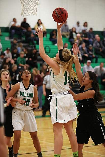 Fallon senior Chandler McAlexander scores in the paint against North Valleys on Saturday.