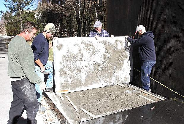 Demolition and removal of the damaged marble surface at the Battle Born Memorial is under way and the contractor expects to finish installing the new marble by the end of next week.