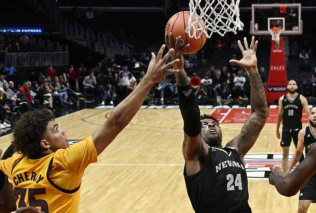 Nevada forward Jordan Caroline shoots as Arizona State forward Taeshon Cherry defends during Friday's game at the Basketball Hall of Fame Classic in Los Angeles.