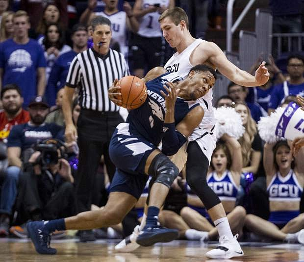 Nevada's Tre'Shawn Thurman tries to get around Grand Canyon's Gerald Martin during the first half of an NCAA college basketball game Sunday, Dec. 9, 2018, in Phoenix. (AP Photo/Darryl Webb)