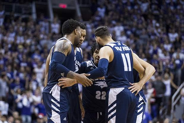 Nevada players Jordan Caroline (24), Tre'Shawn Thurman (0), Jazz Johnson (22), Caleb Martin (10) and Cody Martin (11) huddle during the second half of Sunday's game against Grand Canyon.