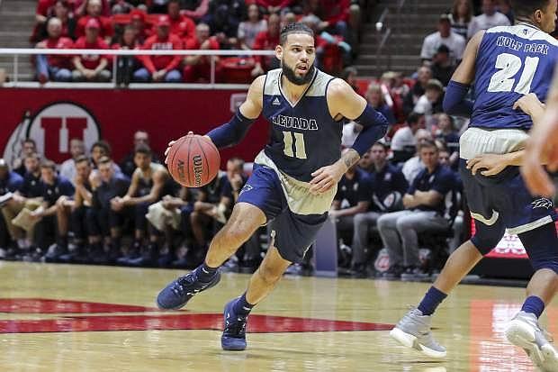 Nevada forward Cody Martin (11) dribbles the ball against Utah during the first half of an NCAA college basketball game, Saturday, Dec. 29, 2018, in Salt Lake City. Nevada won 86-71. (AP Photo/Chris Nicoll)