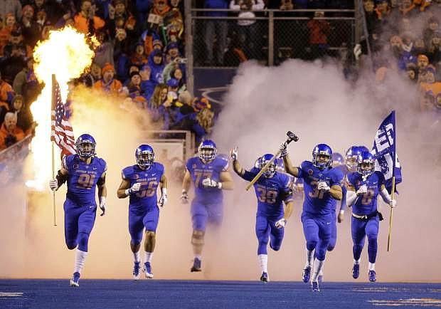 Boise State runs on to the field beforeits game with Utah State on Saturday in Boise, Idaho. Boise State won 33-24.