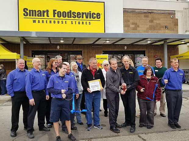 Mayor Bob Crowell and Ben Wiseman, store manager, cut the ribbon on the Smart Foodservice Warehouse Stores location at 222 Fairview Drive. The store is holding a grand opening Saturday.
