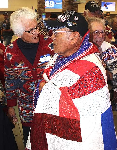 Reynold Sammaripa of Schurz wears a hand-sewn quilt at the Reno-Tahoe International Airport.