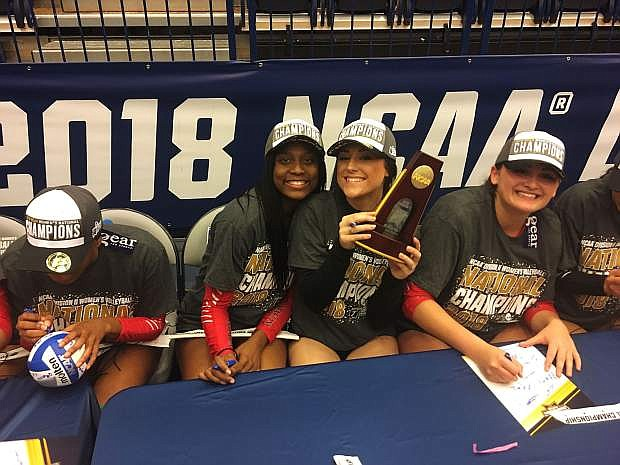 Natalie Anderson with her teammates after winning the national title.
