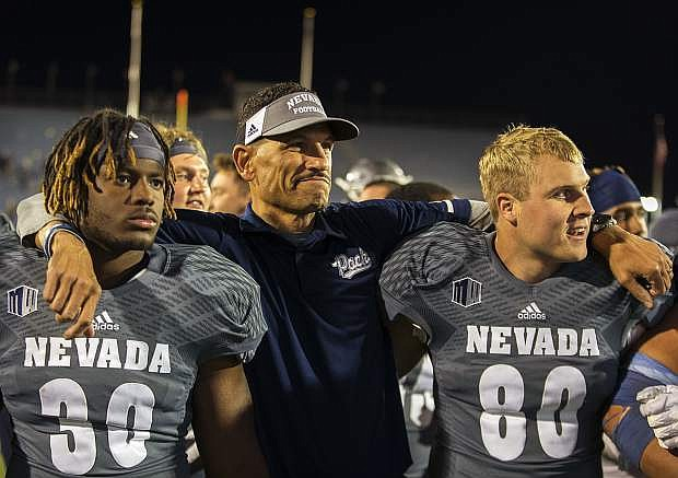 Nevada head coach Jay Norvell celebrates with his team after beating San Diego State 28-24 in a NCAA college football game in Reno, Nev., Saturday, Oct. 27, 2018. (AP Photo/Tom R. Smedes)
