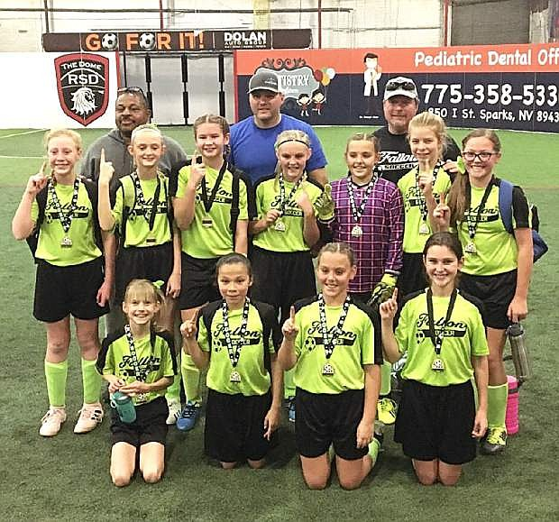 The Fallon U12 Girls indoor soccer team won the Reno Sportsdome Indoor Soccer League Championship on Saturday. Fallon eliminated Truckee last weekend, 5-3, and then beat Reno on Saturday, 7-2, for the championship. During the season, Fallon defeated teams from Reno, Lake Tahoe, Truckee and Carson to earn the No. 2 seed for the tournament. The team includes, back row, from left: coaches Kelly Spicer, Darren Simper and Kevin Snodgrass. Middle row, from left: Ambreea Snodgrass, Kaitlin Goings, Dylan Faught, Kylee Simper, Kortnie Simper, Halle Johnson and Payton Oceguera. Bottom row, from left: Mirabel Windriver, Jada Anastasio, Karlie Simper and Alyssa Ayers.