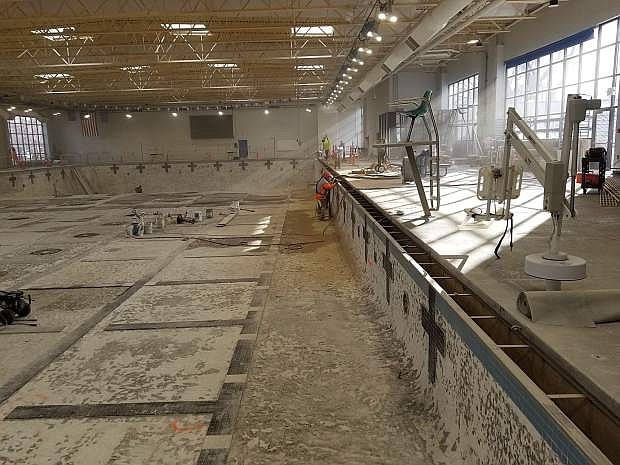 A Tahoe Pool & Spa Construction crew chip away at the Aquatic Facility Olympic-sized indoor pool, which will be entirely re-plastered as part of a $555,000 rehabilitation project at the facility.