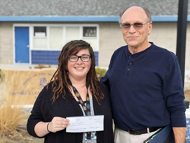 Keith Squires, Carson City Schools Foundation board member, right, delivered a check to Kelly Ehrenfeuchter, music teacher at Empire Elementary School. Ehrenfeuchter is a recipient of the foundation's mini-grant program designed to facilitate creative learning in the classroom.