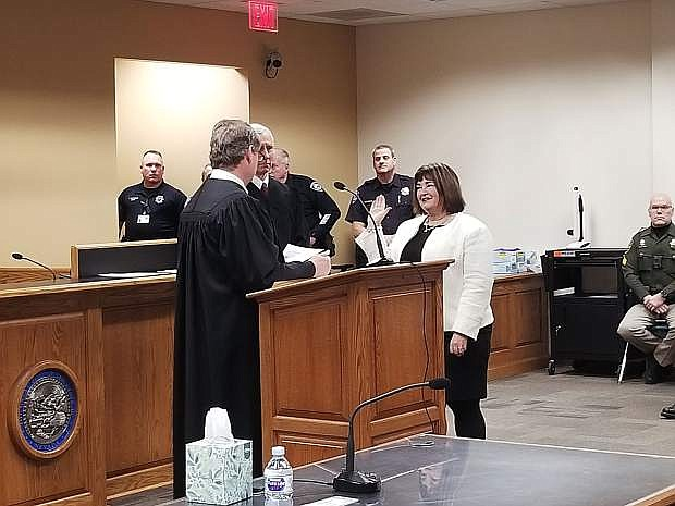 Judge James E. Wilson swears in Ward 3 Supervisor Lori Bagwell.