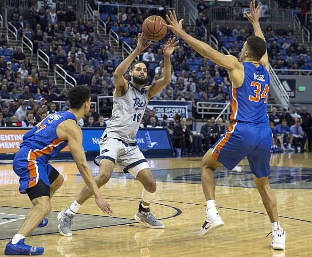 Nevada forward Cody Martin's (11) passes the ball in the first half on Saturday.