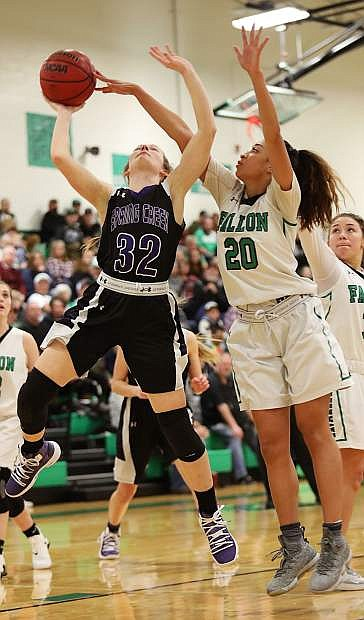 Fallon senior Leilani Otuafi blocks Spring Creek's Caitlyn Dimick's shot in the second half on Saturday.