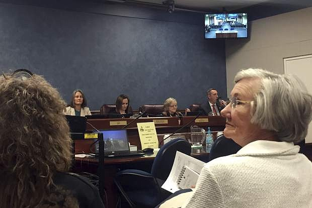 People gather at the Nevada Legislature in Carson City before a hearing on a bill that would allow terminal patients to kill themselves with medication prescribed by a doctor Monday, Feb. 25, 2019. (AP Photo/Ryan Tarinelli)