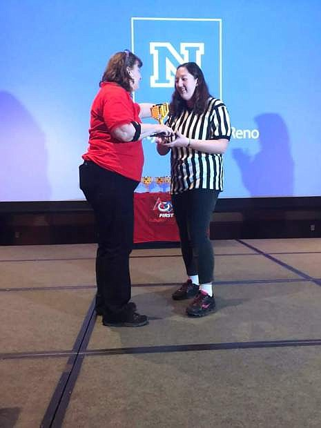 Nanami Duncan, right, a junior at Carson High School, received the Outstanding Volunteer award for her work in the FIRST LEGO League program.