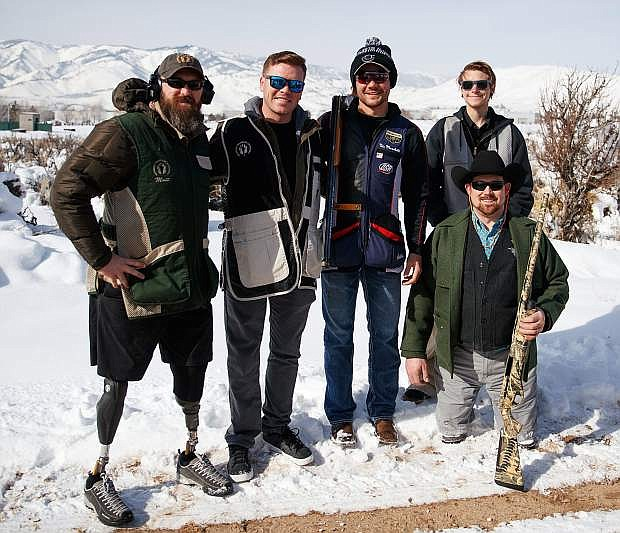 A Team Photo, from left, Wounded Warriors Special Guests Matt Amos and Brian Meyer with USA Shooting Team Member Nic Moschetti and guests Justin Rose and Israel Hale (front right) during the Wild Sheep Foundation/USA Shooting Team Sporting Clays Shoot at the Capitol City Gun Club.
