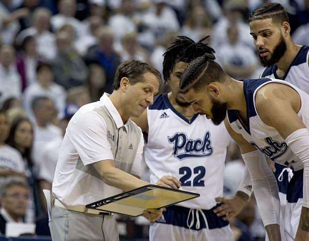 Nevada head coach Eric Musselman draws up a play against Fresno State in the second half of an NCAA college basketball game in Reno, Nev., Saturday, Feb. 23, 2019. (AP Photo/Tom R. Smedes)