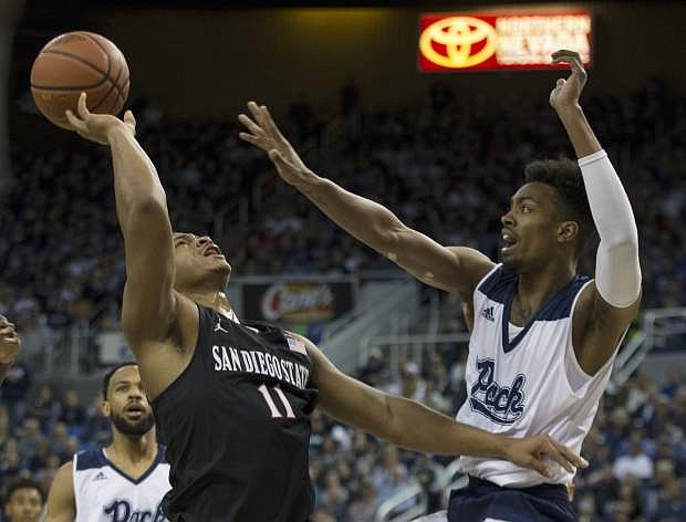 San Diego State forward Matt Mitchell is guarded by Nevada forward Jordan Brown during Saturday's game in Reno.
