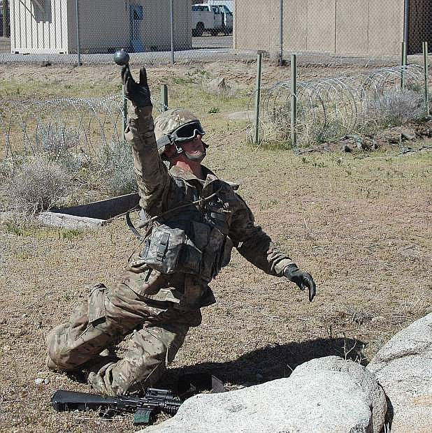 In this file photo from the 2017 Nevada Guard Best Warrior contest, a Nevada Guard soldier tosses a mock grenade for distance and accuracy. The annual Best Warrior contest tests guardsmen in a variety of combat skills. This year, Tongan Marines are participating in the event in Hawthorne.
