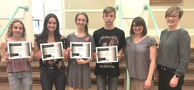 CCSD Board President Kathryn Whitaker, right, honors Churchill County High School art students for their success at the Sierra Nevada College Flat Rate Exhibition. From left are students Macall Brown, Rylee Buckmaster, Melanie Plasse and JD Steele and instructor Jaime Shafer.