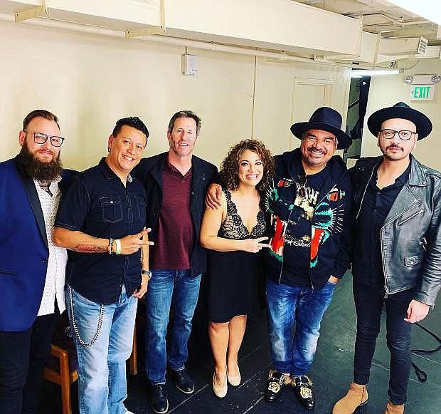 Audio Sky poses with comedian George Lopez backstage at the Bob Hope Theatre in Stockton, Calif., on March 23.