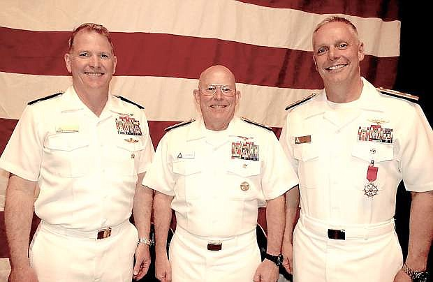 From left are Rear Adm. Richard T. Brophy, Vice Adm. DeWolfe Miller,  and Rear Adm. Daniel Cheever.