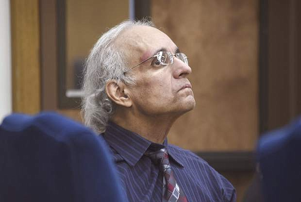 FILE - In this May 10, 2019 file photo Tracy Petrocelli, 67, a convicted murderer who has been on death row in Nevada for 34 years, listens to testimony during his re-sentencing hearing in Washoe District Court in Reno, Nev. A week-long re-sentencing hearing is nearing the end for Petrocelli. Closing arguments were scheduled in state court in Reno Thursday, May 16, 2019. (Jason Bean/The Reno Gazette-Journal via AP, Pool, File)