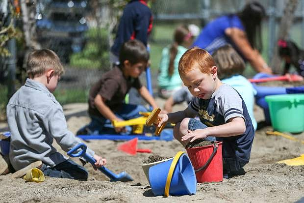 Luke Walls, 5, and fellow pre-K students play at recess at Mark Twain Elementary School in Carson City on May 26, 2015.