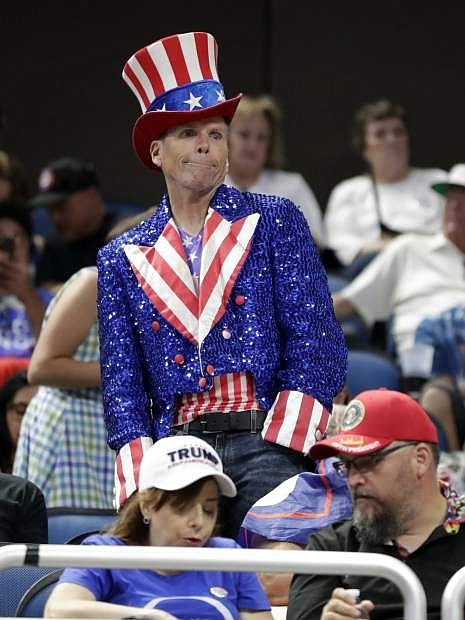 A supporter dances to music at a rally where President Donald Trump will announce his 2020 re-election bid Tuesday, June 18, 2019, in Orlando, Fla. (AP Photo/John Raoux)