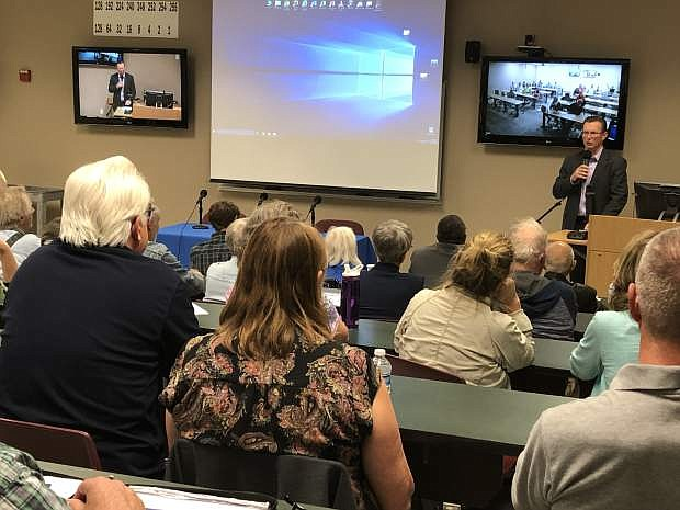 Nevada State Sen. Ben Kieckhefer welcomes a crowd of about 85 at Thursday night's climate change panel at Western Nevada College.