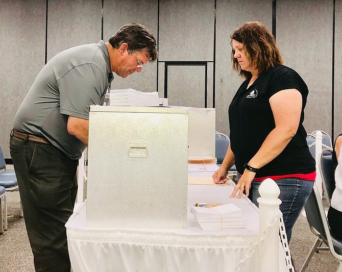 city council will canvas the votes according to state law at its next meeting on Monday and certify the winner.Photo: City Clerk Gary Cordes, left, and Deputy City Clerk Elsie Lee prepare ballots for counting.