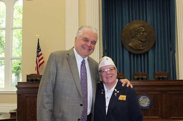 Gov. Steve Sisolak and Veterans of Foreign Wars member Denise Estes.